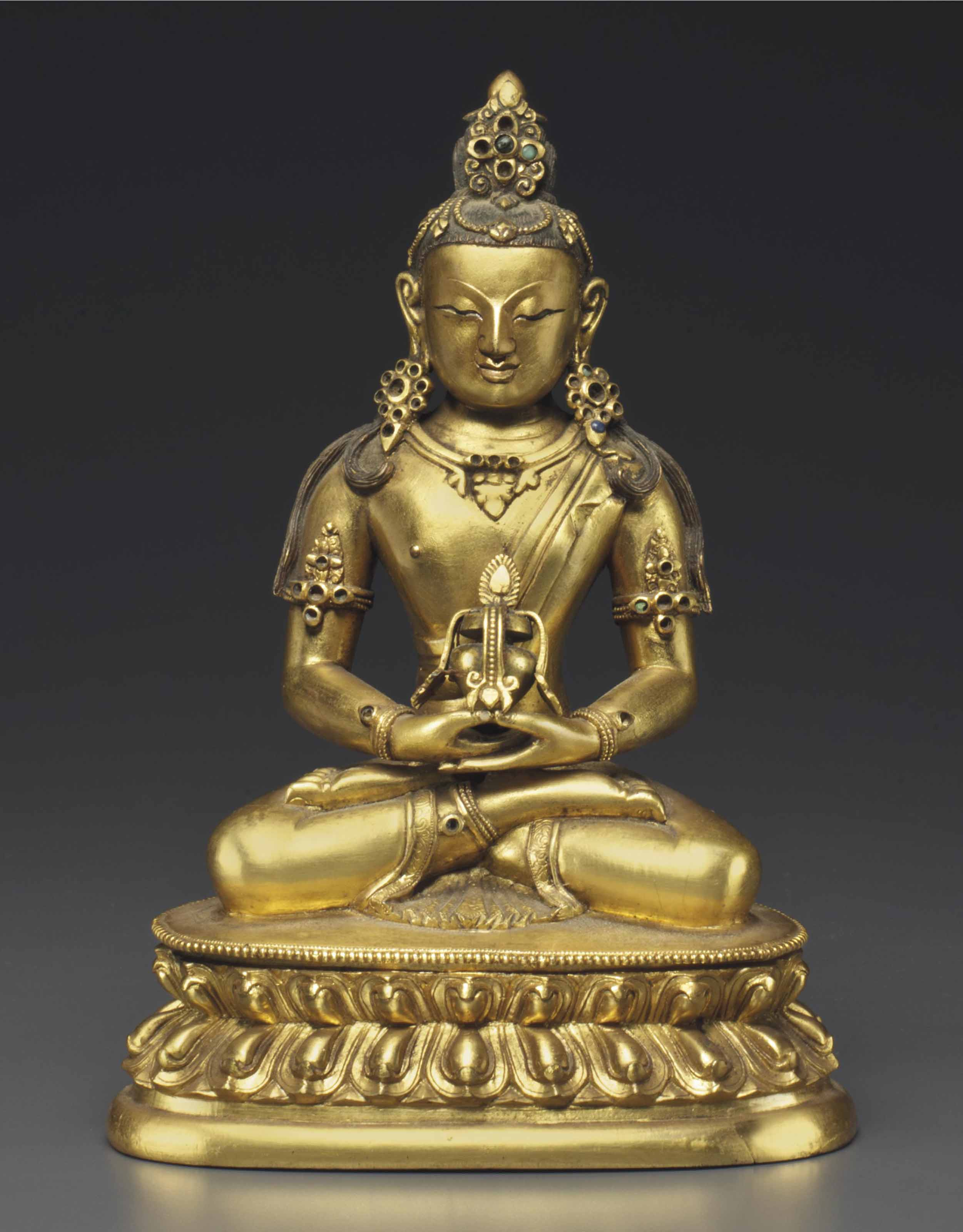 A GILT-BRONZE FIGURE OF AMITAY