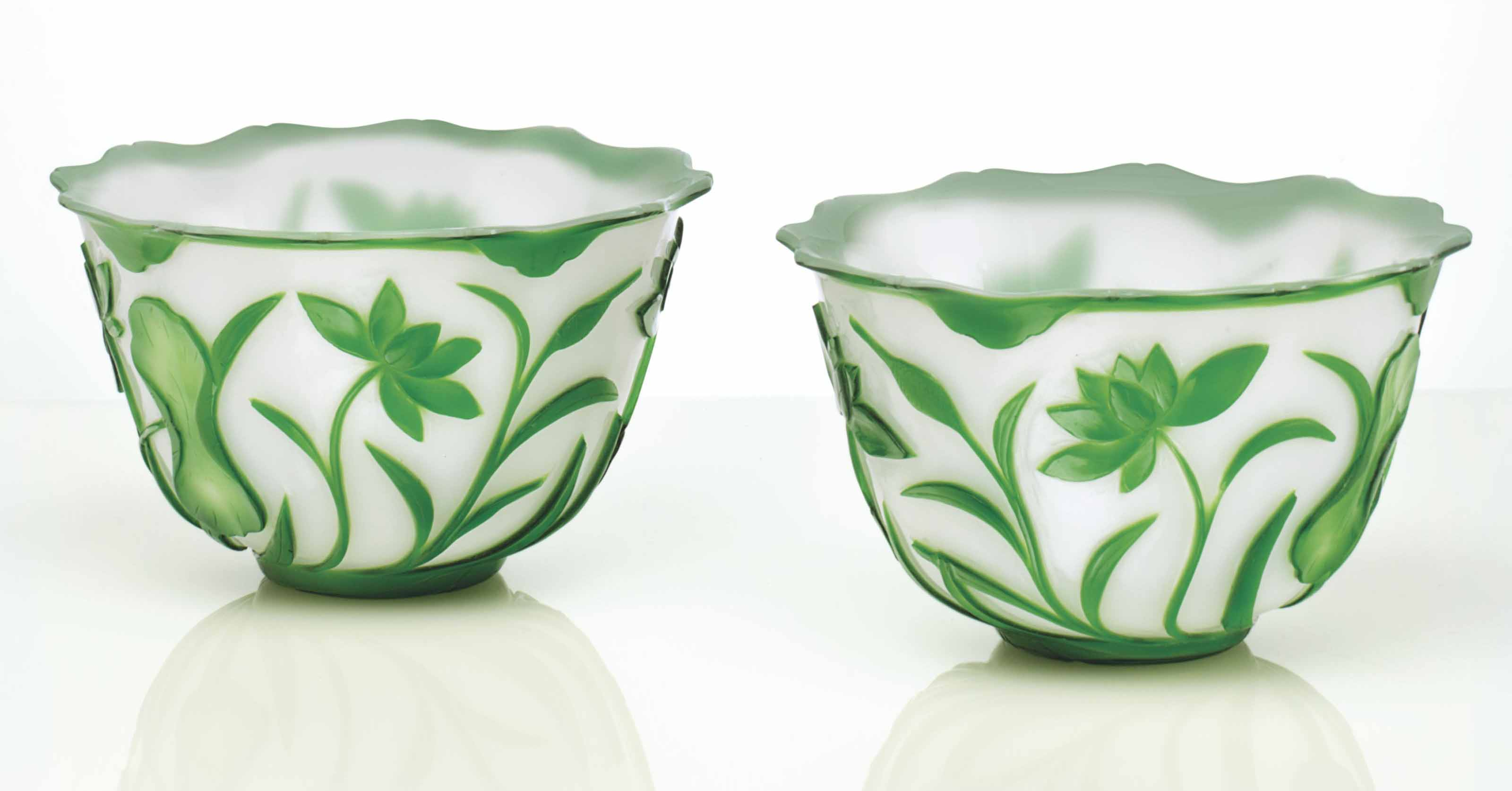 A PAIR OF CARVED GREEN-OVERLAY
