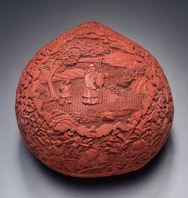 A CARVED RED LACQUER PEACH-FOR