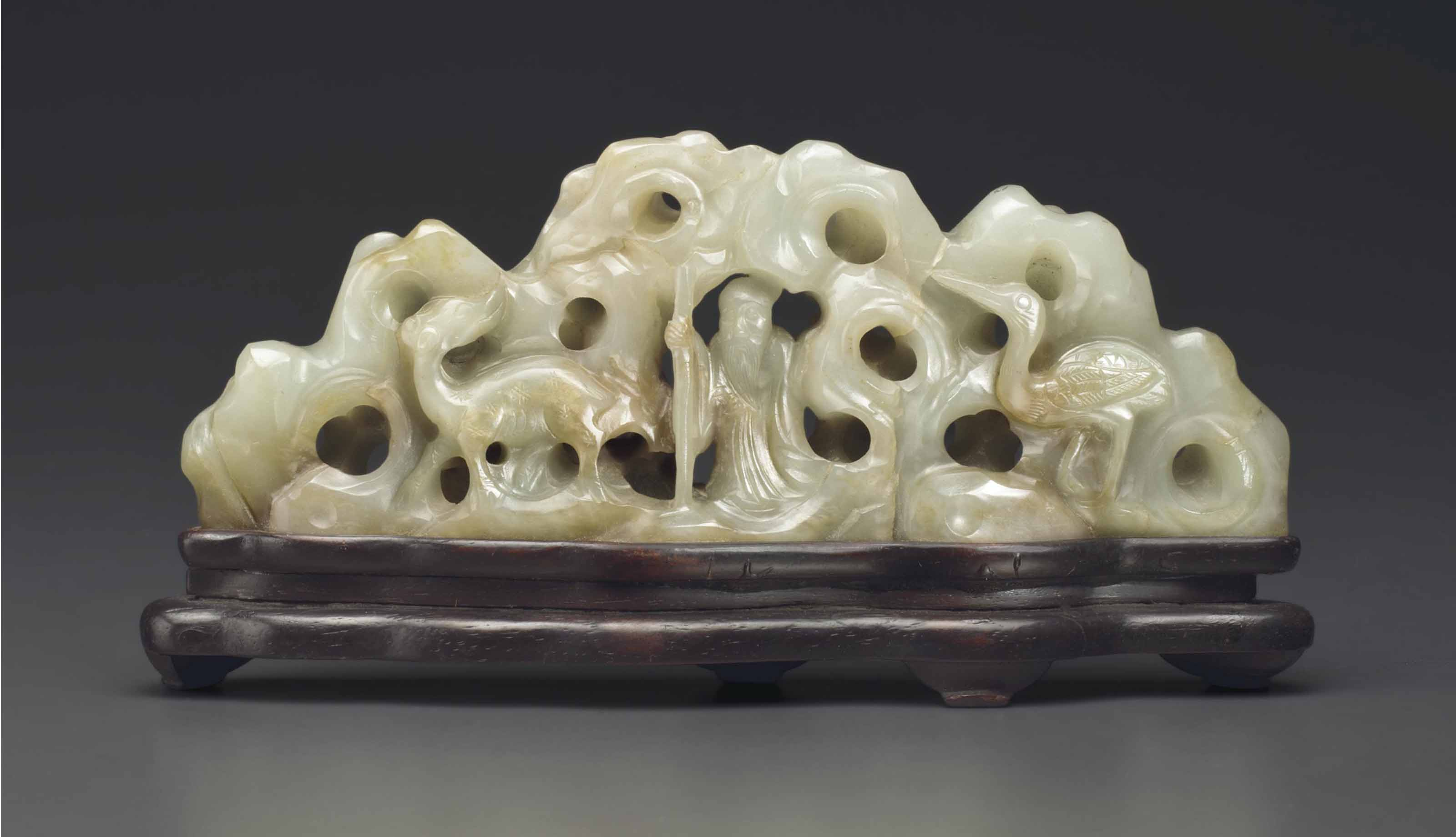 A JADE PIERCED BRUSH REST