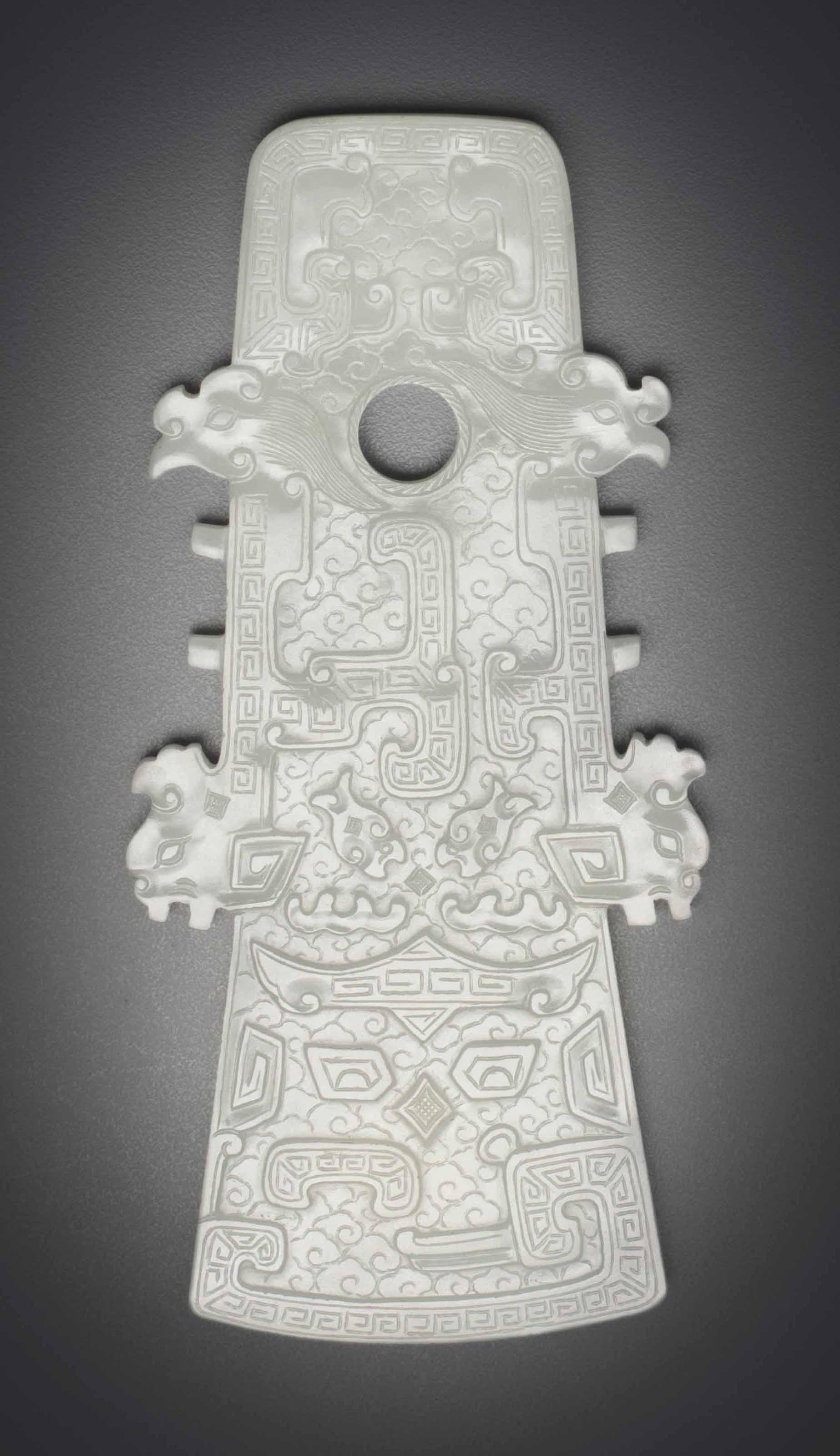 A WHITE JADE ARCHAISTIC AXE-FO