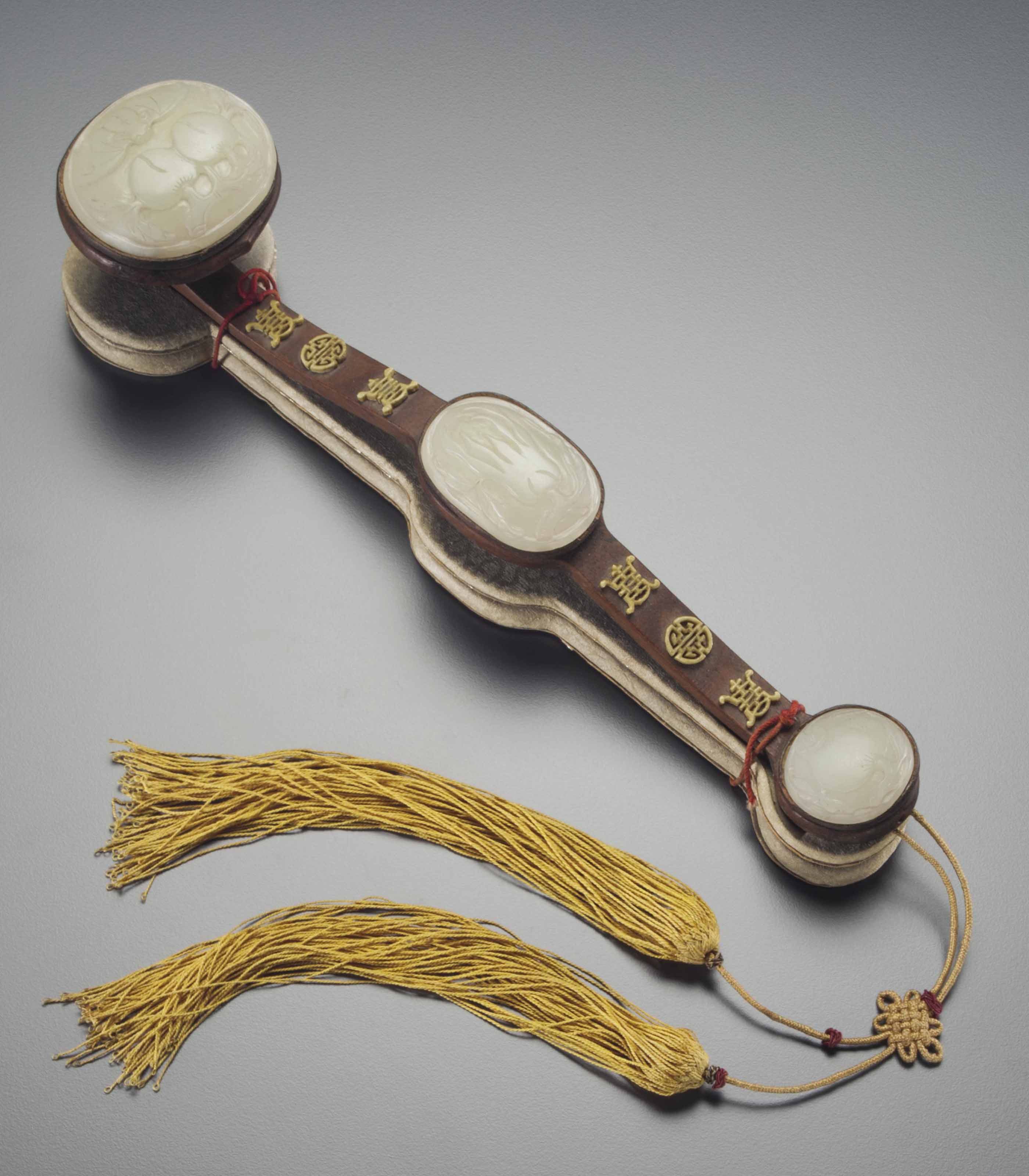 A JADE AND IVORY-INSET HARDWOO