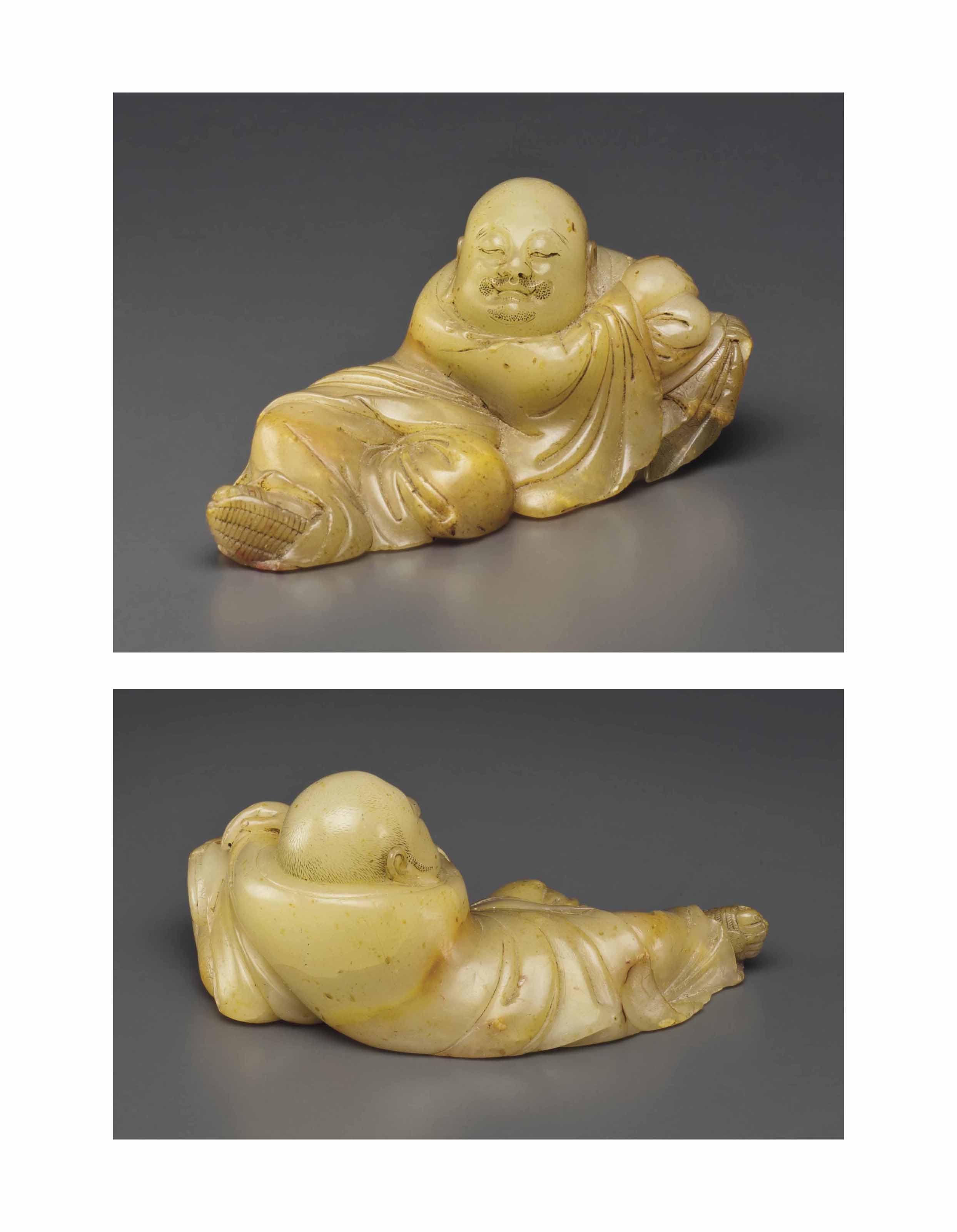 A SMALL SHOUSHAN SOAPSTONE RECLINING FIGURE , 17TH/18TH