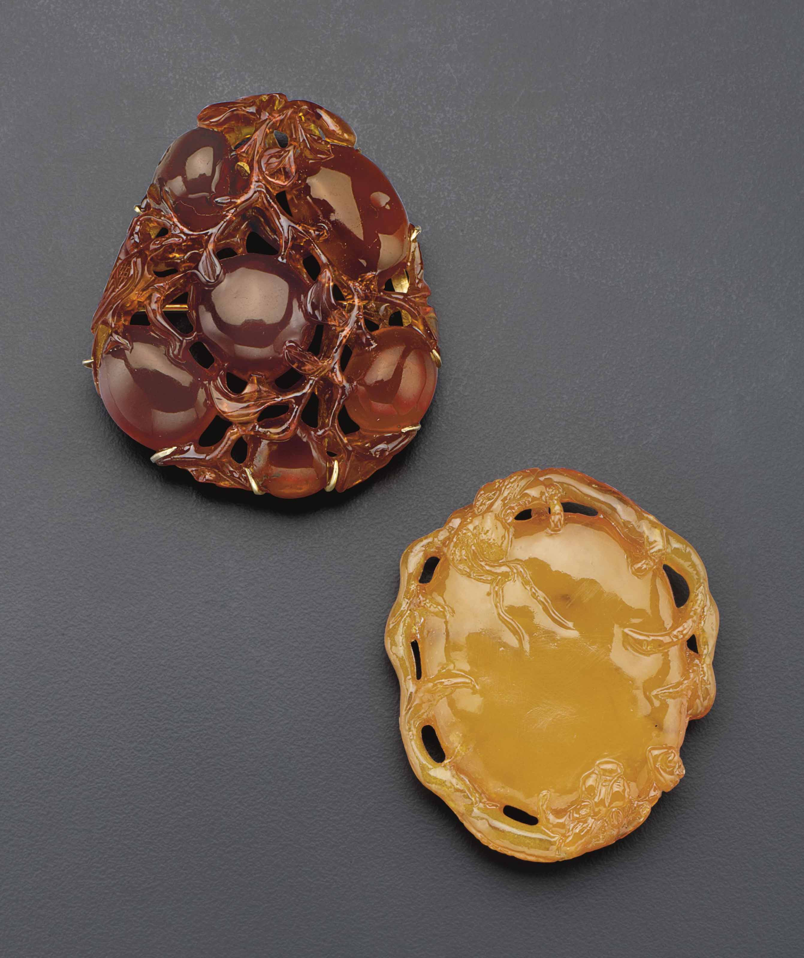 TWO SMALL AMBER CARVINGS