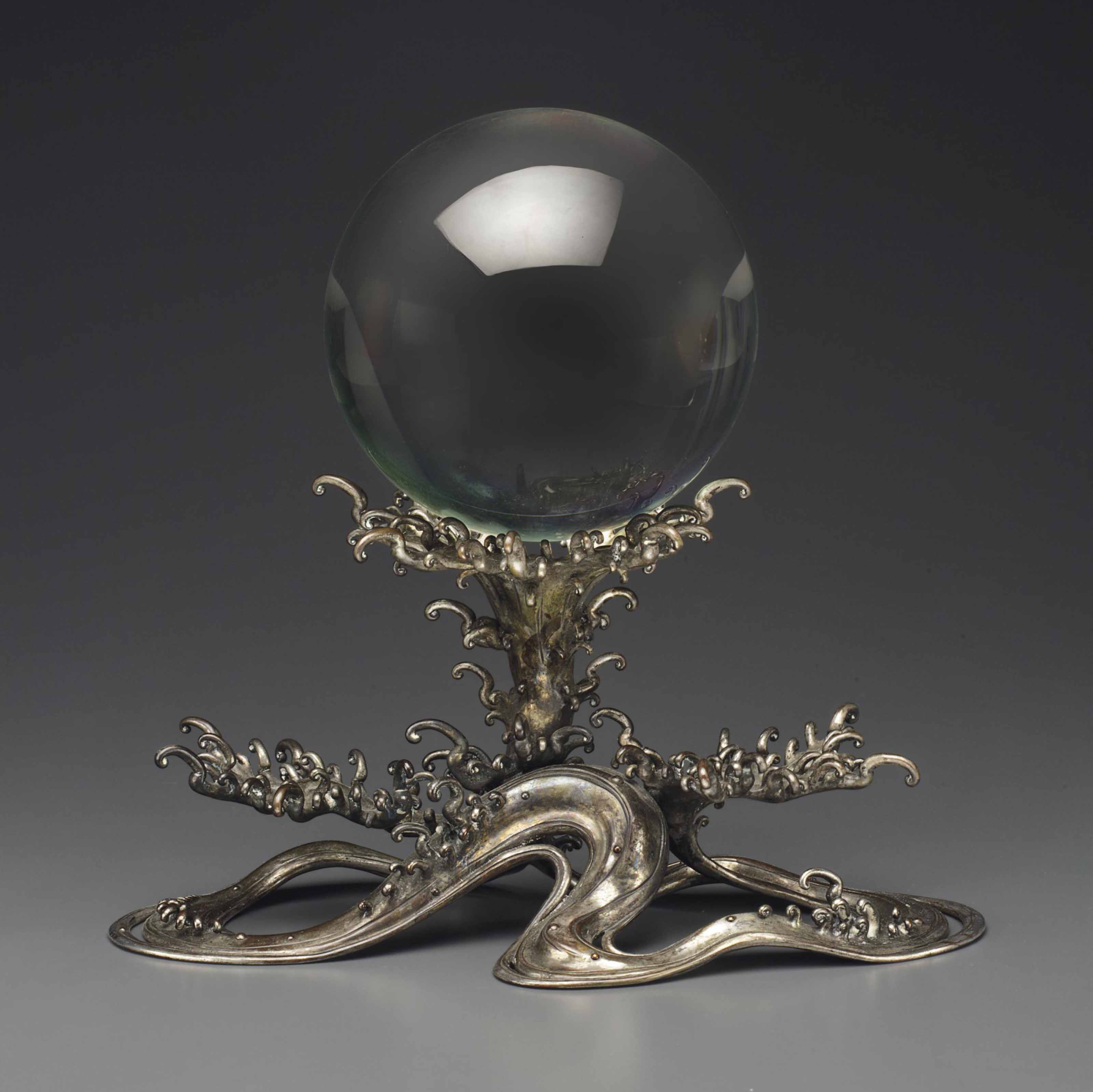 A LARGE ROCK CRYSTAL SPHERE ON