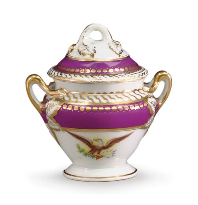 A CUSTARD CUP AND COVER FROM A