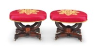 A PAIR OF CLASSICAL ROSEWOOD OVAL STOOLS
