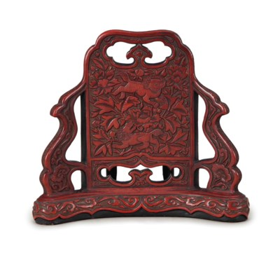 A CHINESE CARVED RED LACQUER T