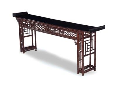 A STAINED BAMBOO ALTER TABLE,