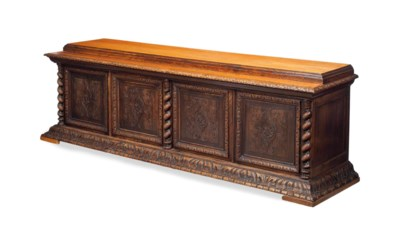 A CONTINENTAL CARVED OAK LARGE