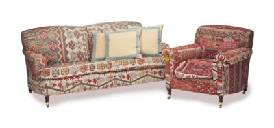 AN UPHOLSTERED TWO-SEAT SOFA,
