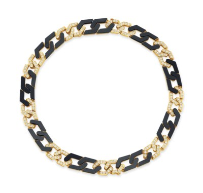 A DIAMOND, ONYX AND GOLD NECKL