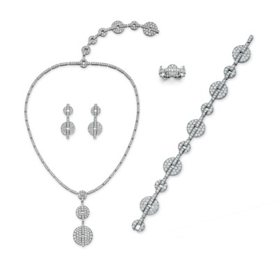 A SUITE OF DIAMOND JEWELRY, BY