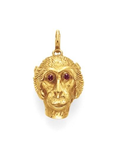 A GOLD MONKEY ZIPPER PULL, BY