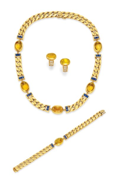 A GROUP OF CITRINE AND GOLD JE