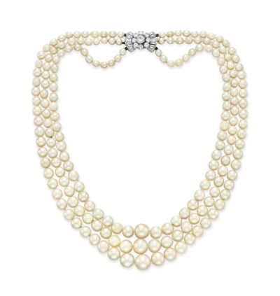 A THREE-STRAND NATURAL PEARL,
