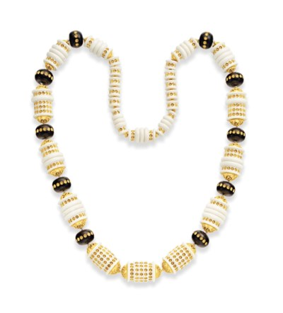 ~AN IVORY AND WOOD BEAD NECKLA