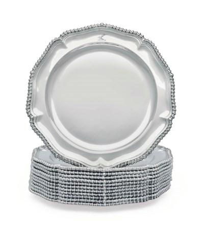 A SET OF TWELVE SILVER DINNER