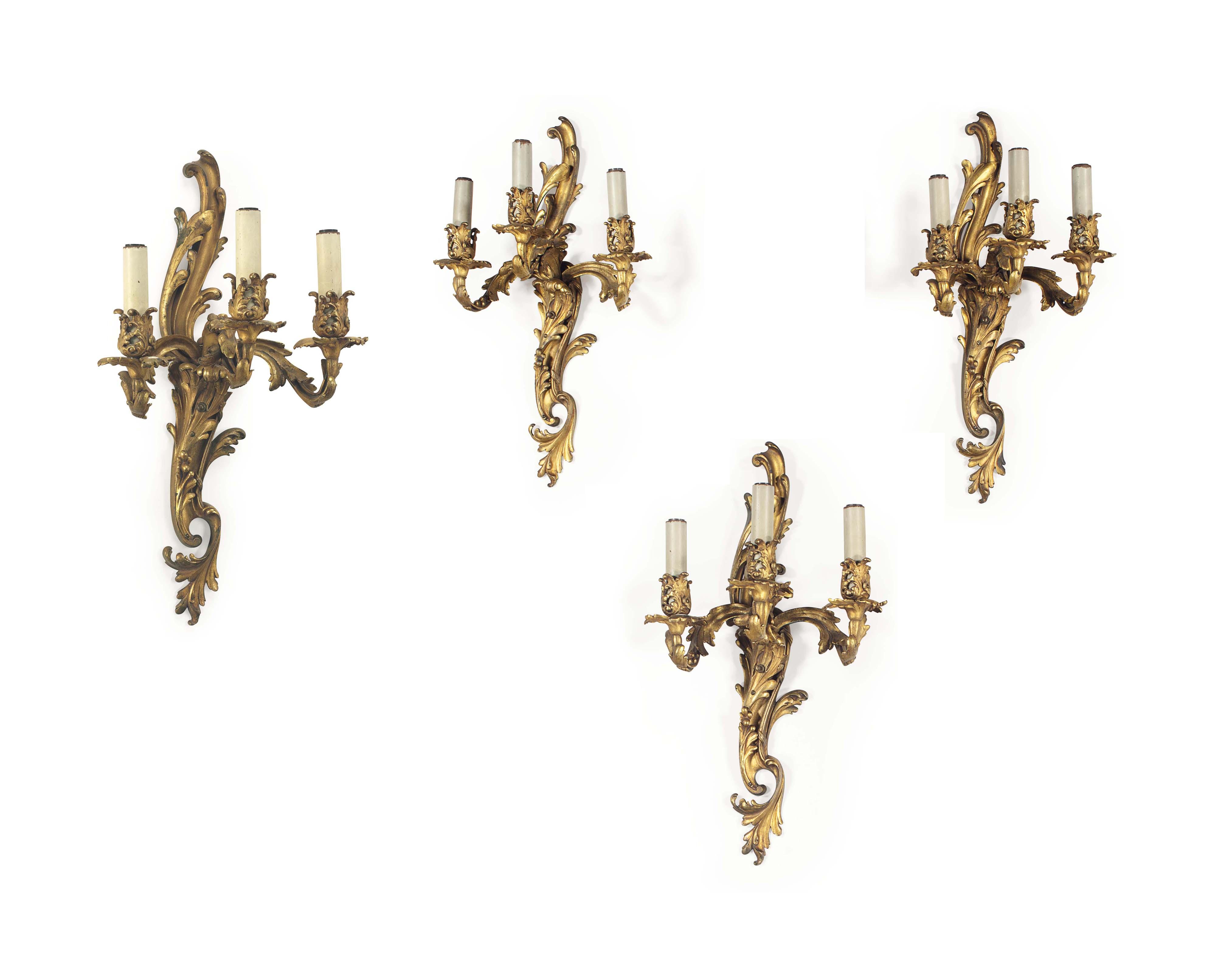 A SET OF SIX ORMOLU THREE-LIGHT WALL LIGHTS