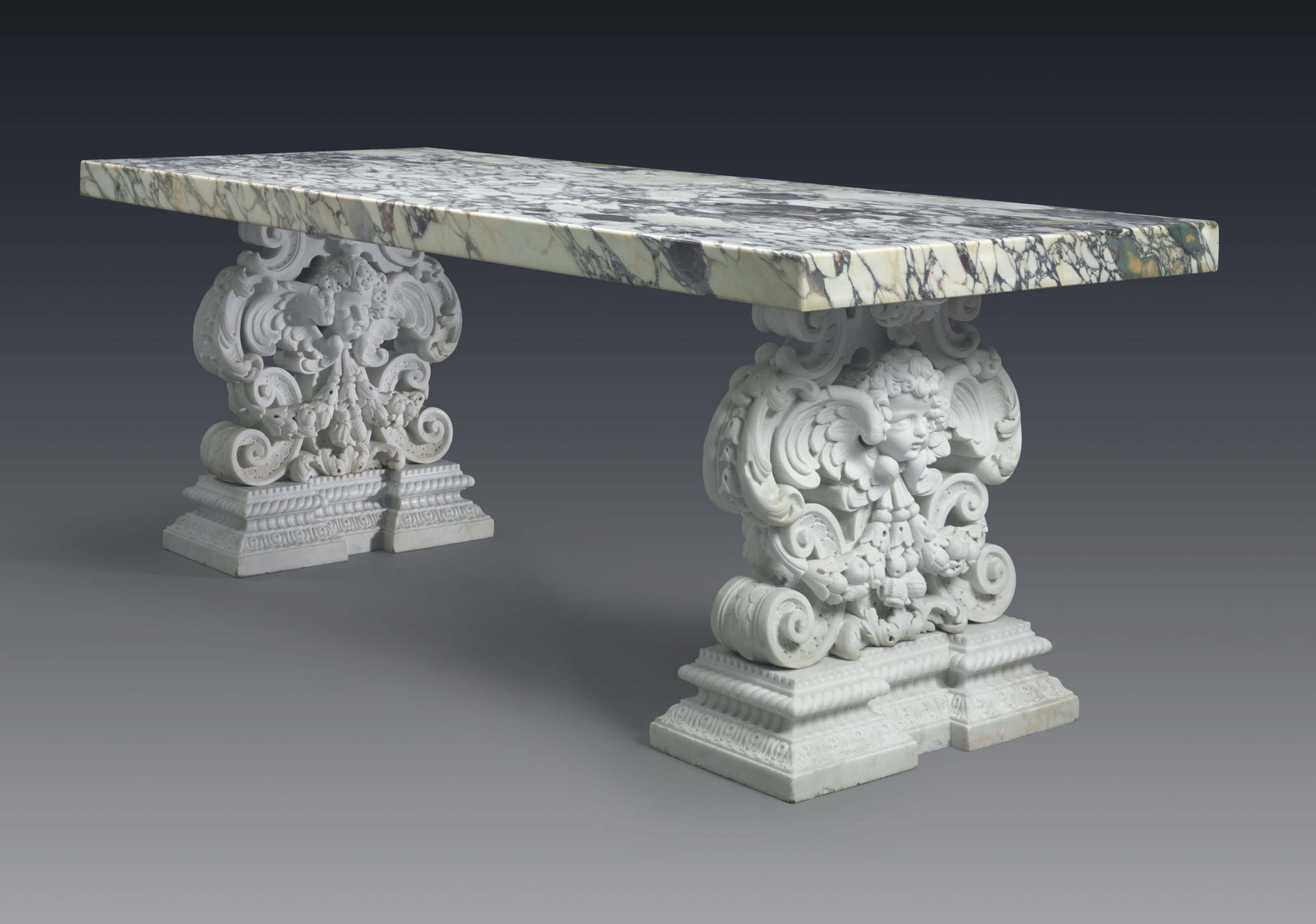 A LARGE AMERICAN WHITE AND BRECHE VIOLETTE MARBLE CENTER TABLE