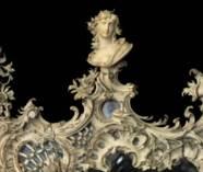 A GERMAN PARCEL-GILT CARVED IV