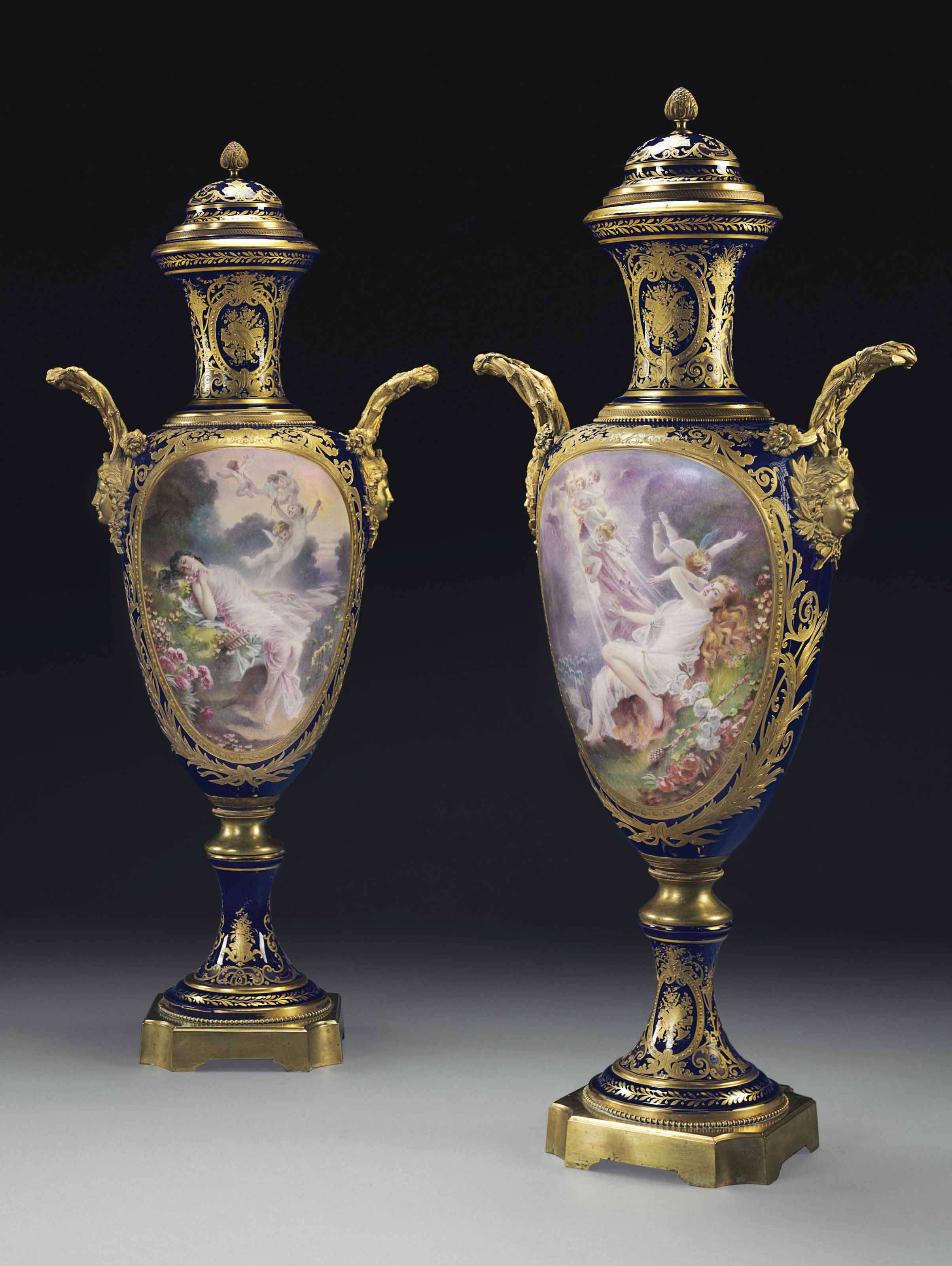 A MONUMENTAL PAIR OF ORMOLU-MOUNTED SEVRES STYLE PORCELAIN COBALT-BLUE GROUND VASES AND COVERS