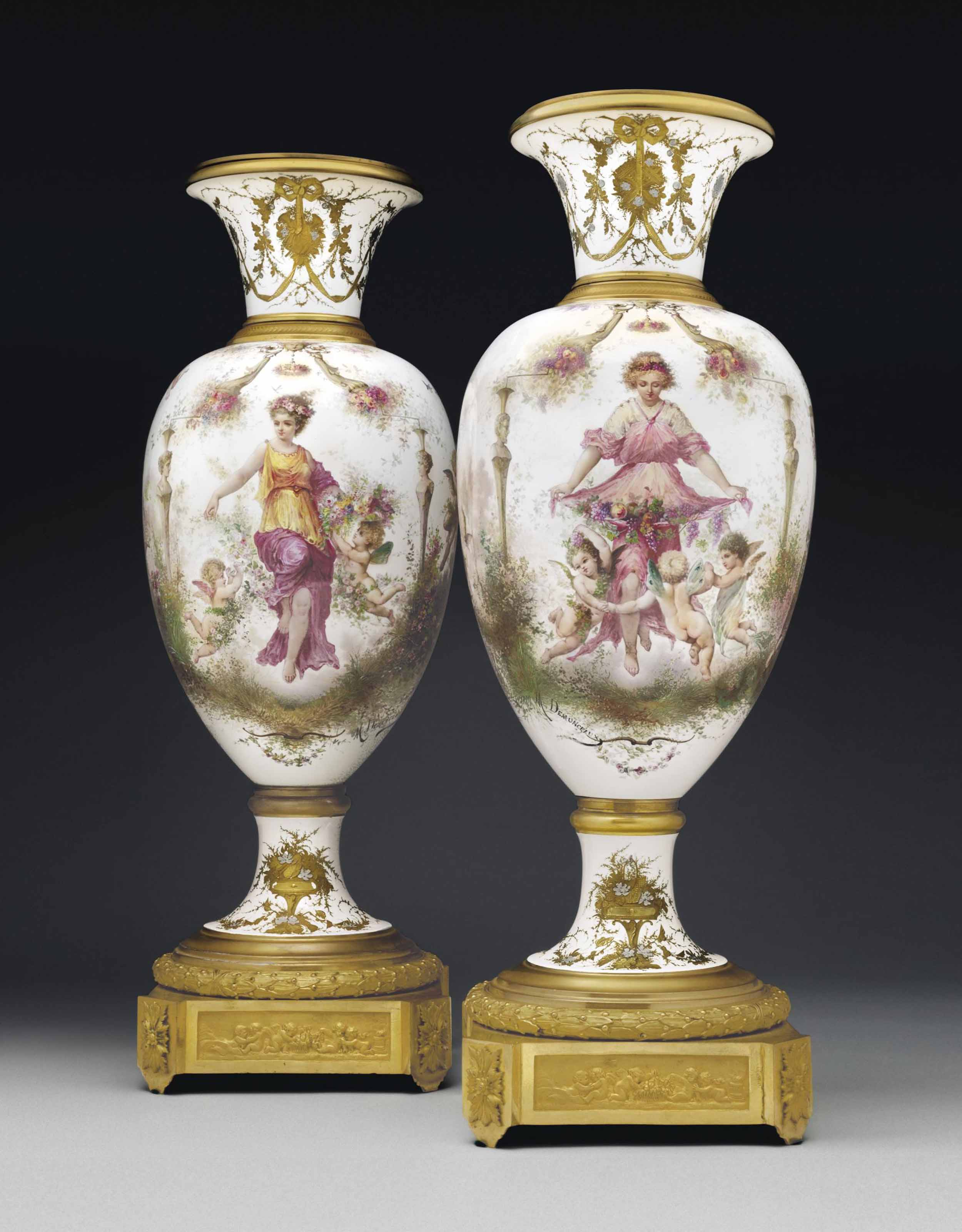 A PAIR OF ORMOLU-MOUNTED SEVRES STYLE PORCELAIN VASES