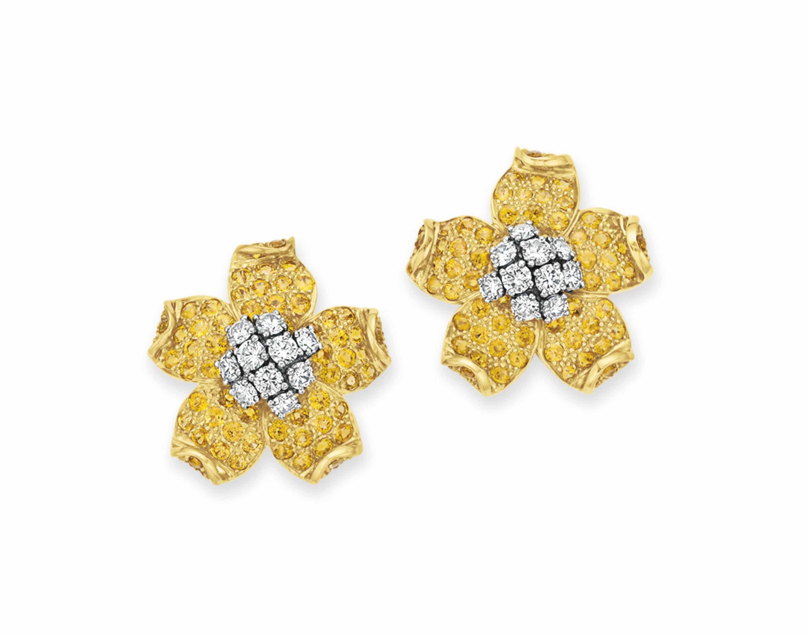 A PAIR OF DIAMOND AND YELLOW SAPPHIRE FLOWER EAR CLIPS, BY WANDER