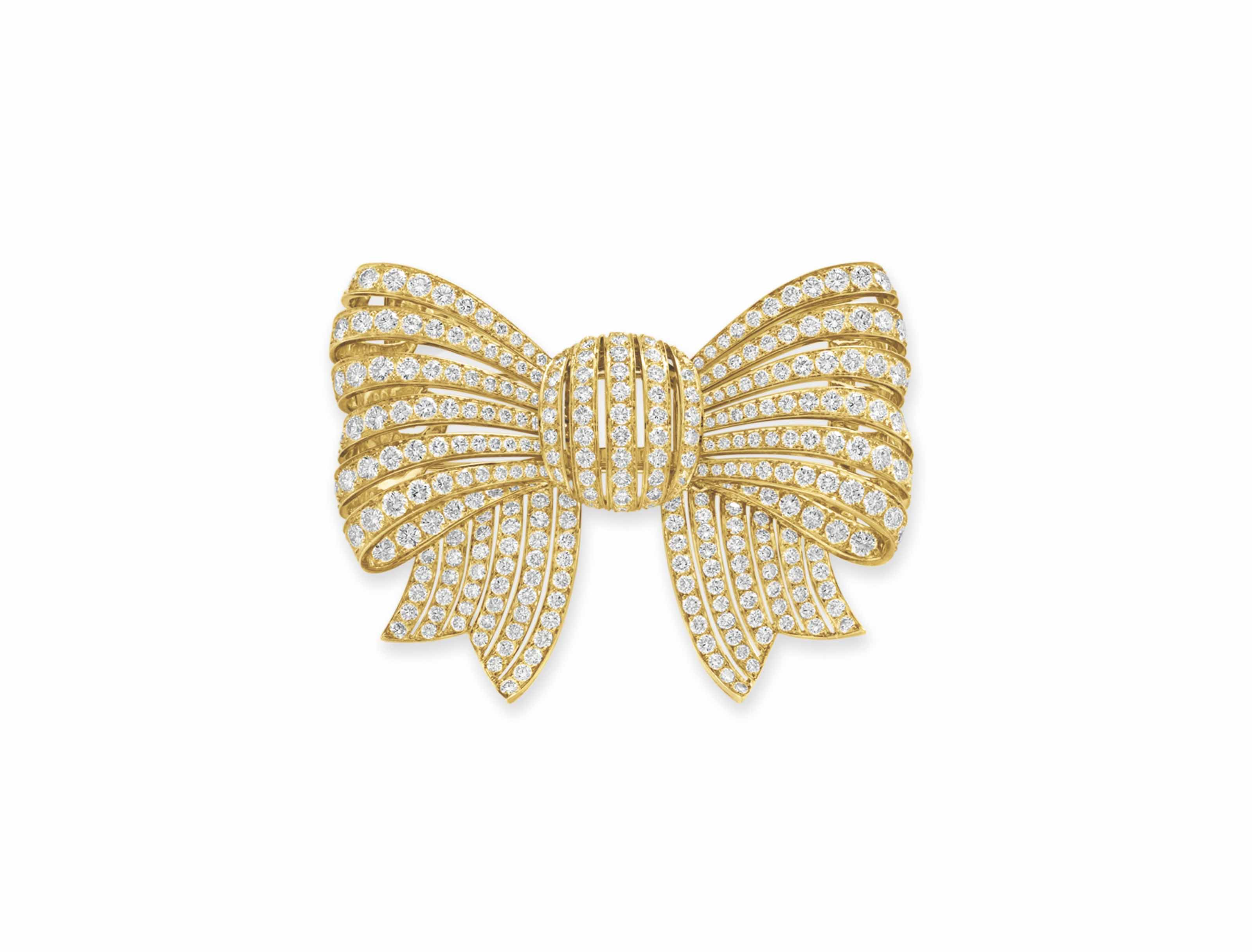 A DIAMOND AND GOLD BOW BROOCH,
