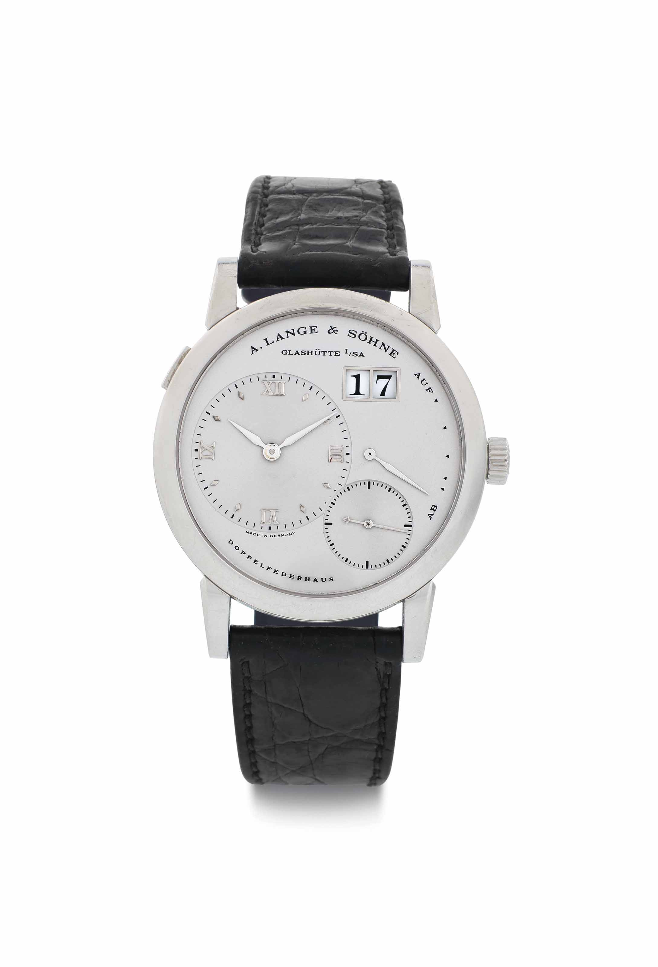 A. Lange & Söhne. A Fine Platinum Twin Barrel Wristwatch with Oversized Date and Power Reserve