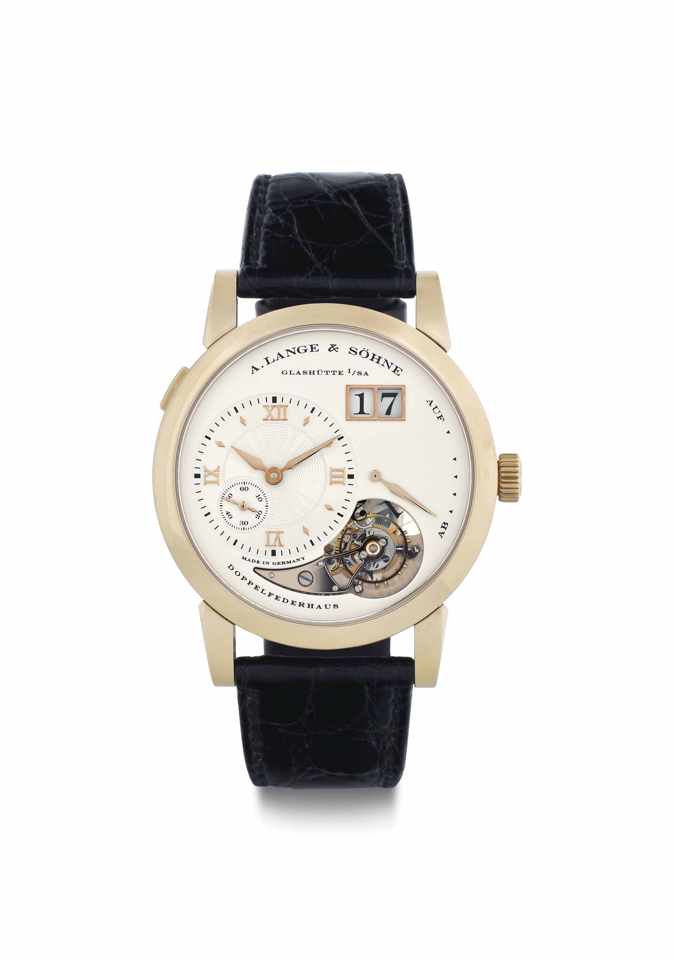 A. Lange & Söhne. A Very Fine and Rare 18k Honey-Colored Gold Limited Edition Tourbillon Wristwatch with Power Reserve, Date, and Hack Feature