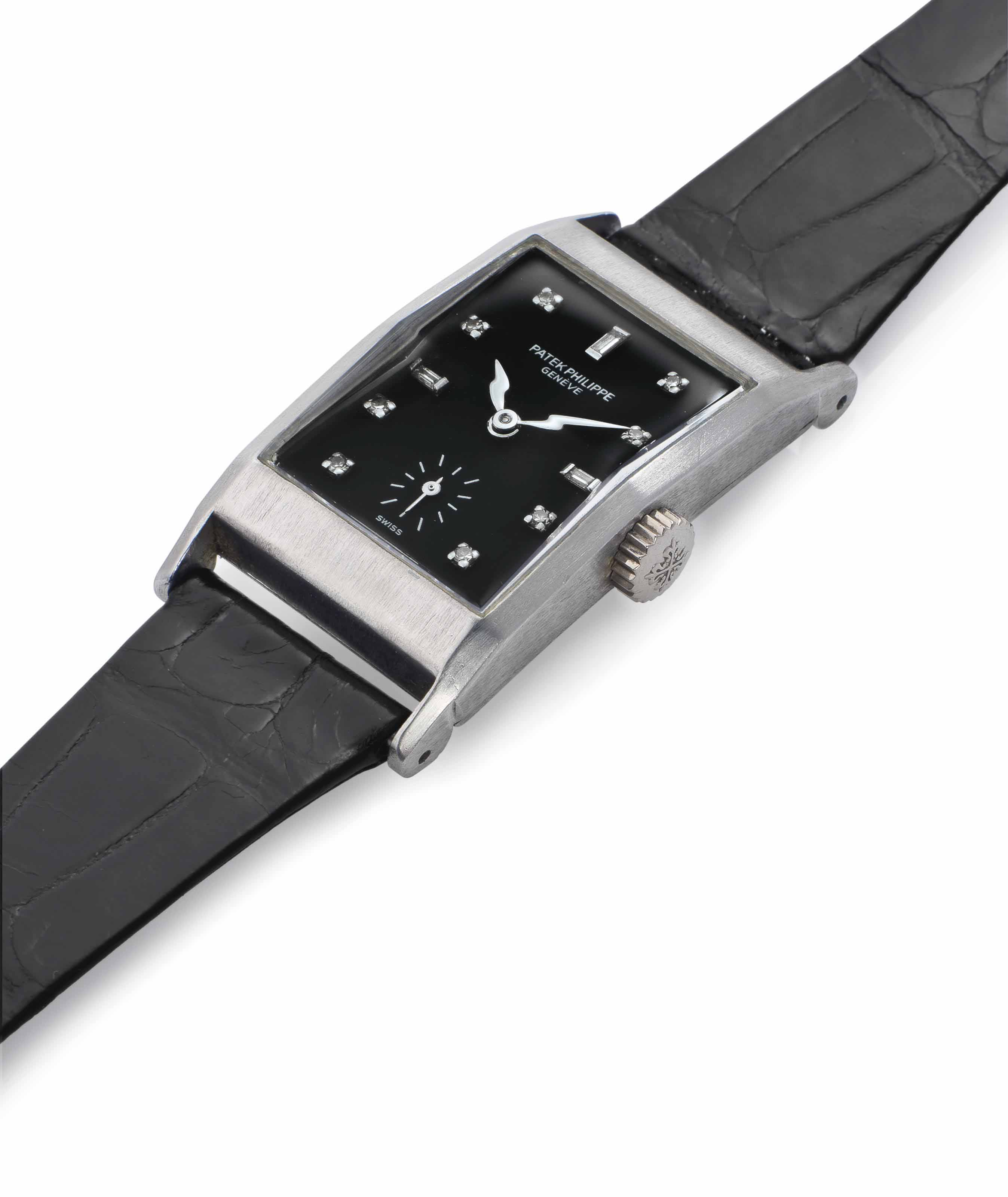 Patek Philippe. A Fine and Very Rare Platinum and Diamond-Set Rectangular Wristwatch with Black Dial