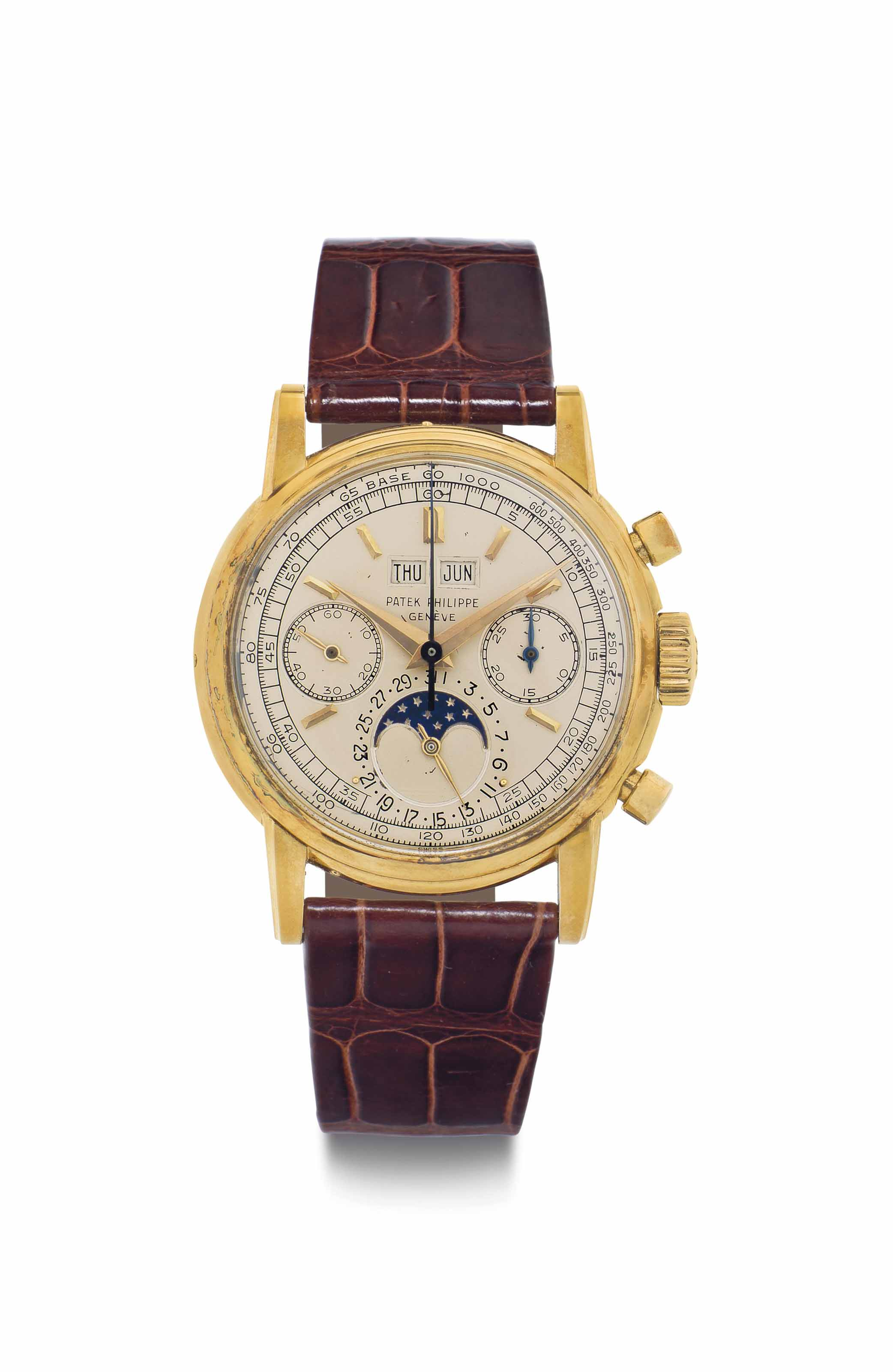 Patek Philippe. A Fine and Very Rare 18k Gold Perpetual Calendar Chronograph Wristwatch with Moon Phases and Tachometer Scale