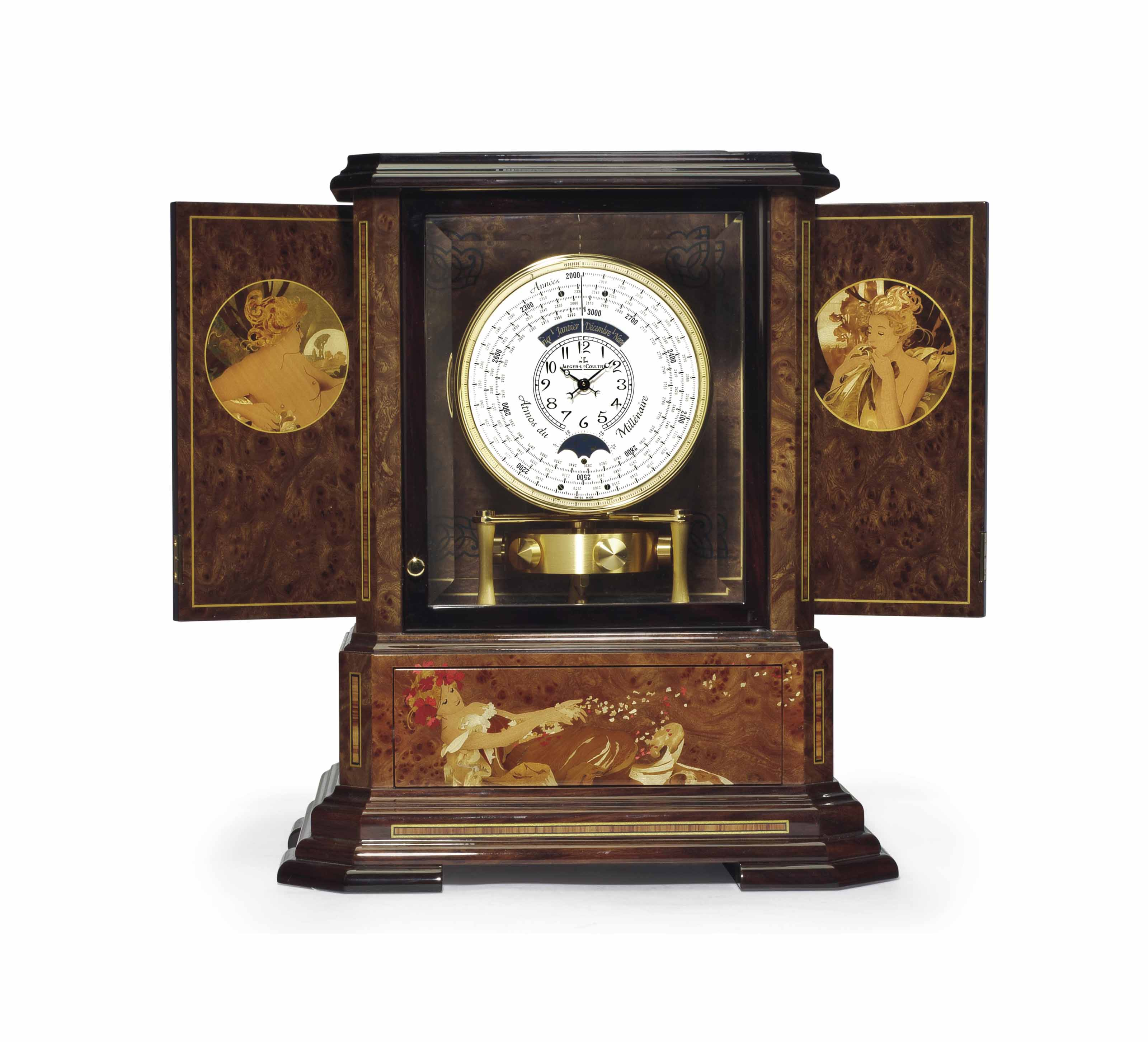 Jaeger-LeCoultre. An Exceptional Limited Edition Wood, Glass and Gilt Barometric Driven Clock with 1000 Year Calendar In The Art Nouveau Style with Original Leather and Brass Bound Fitted Trunk