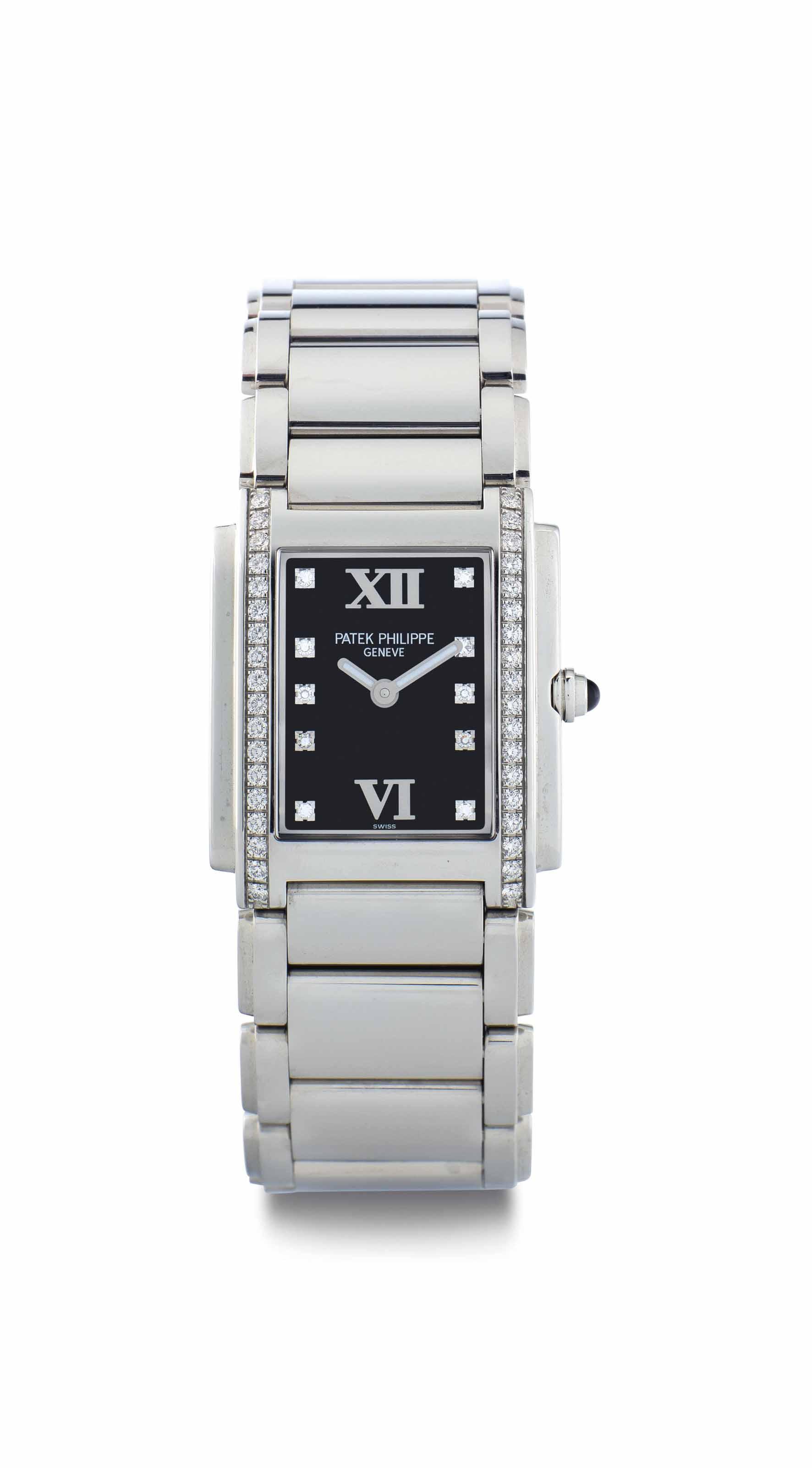 Patek Philippe. A Lady's Fine Stainless Steel and Diamond-Set Rectangular Bracelet Watch
