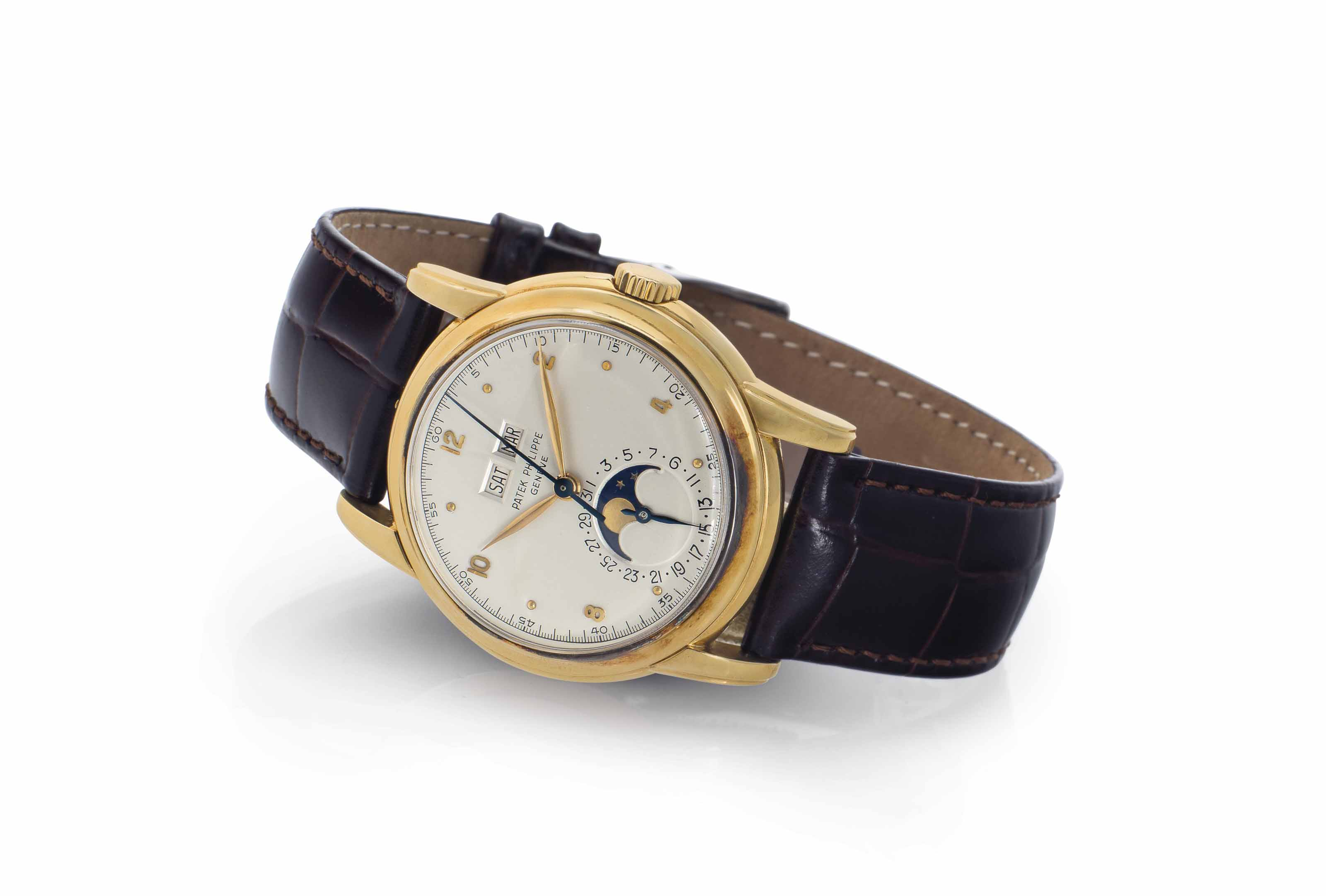 Patek Philippe. A Very Fine and Rare 18k Gold Perpetual Calendar Wristwatch with Center Seconds and Moon Phases
