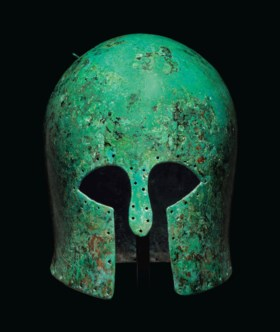 A GREEK BRONZE CORINTHIAN HELMET