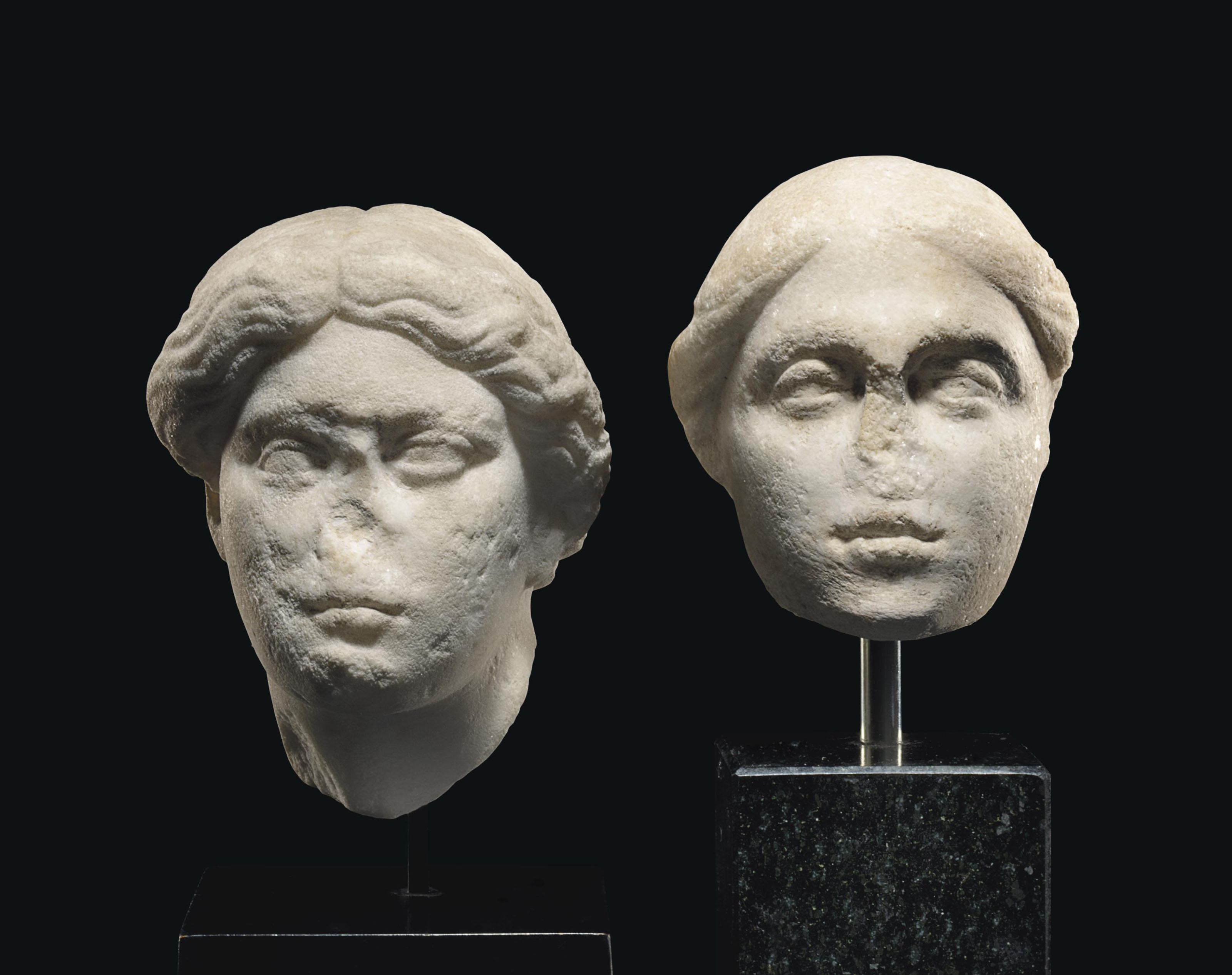 TWO ROMAN MARBLE FEMALE HEADS