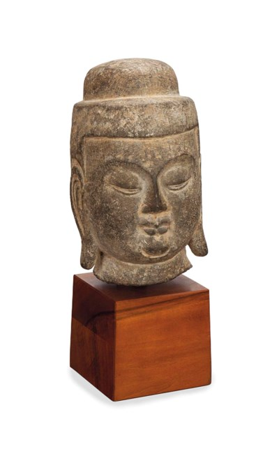 A CHINESE CARVED STONE HEAD OF
