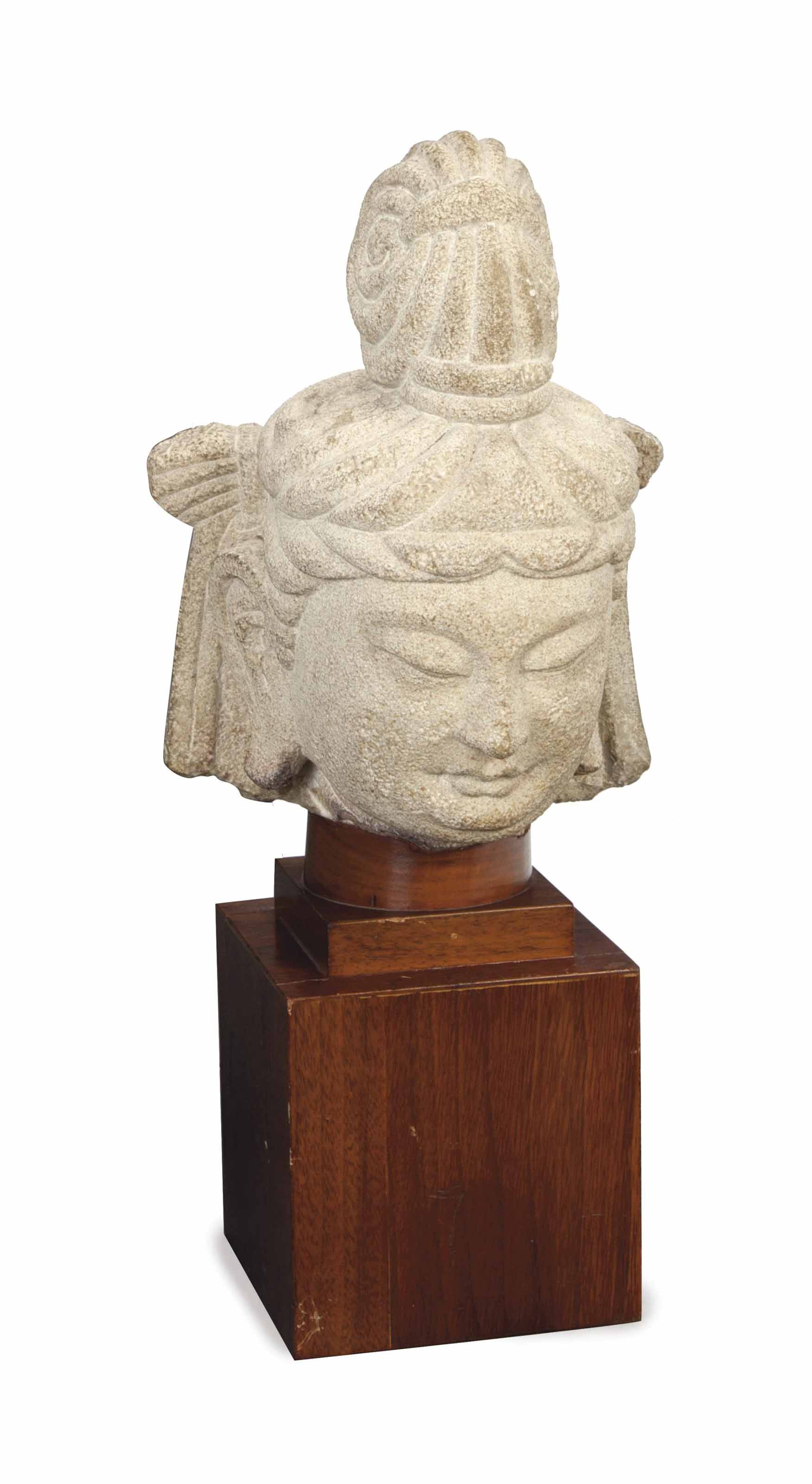 A CHINESE LIMESTONE HEAD OF BO