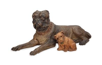 TWO EARTHENWARE FIGURES OF DOG
