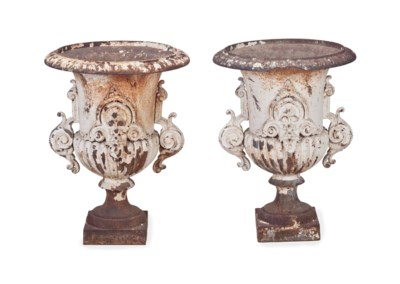 A PAIR OF CAST IRON URNS,