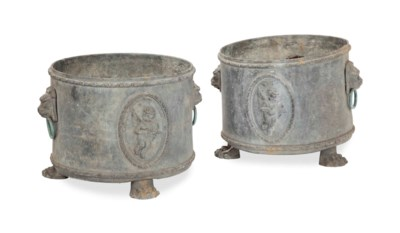 A PAIR OF LEAD ROUND JARDINERE