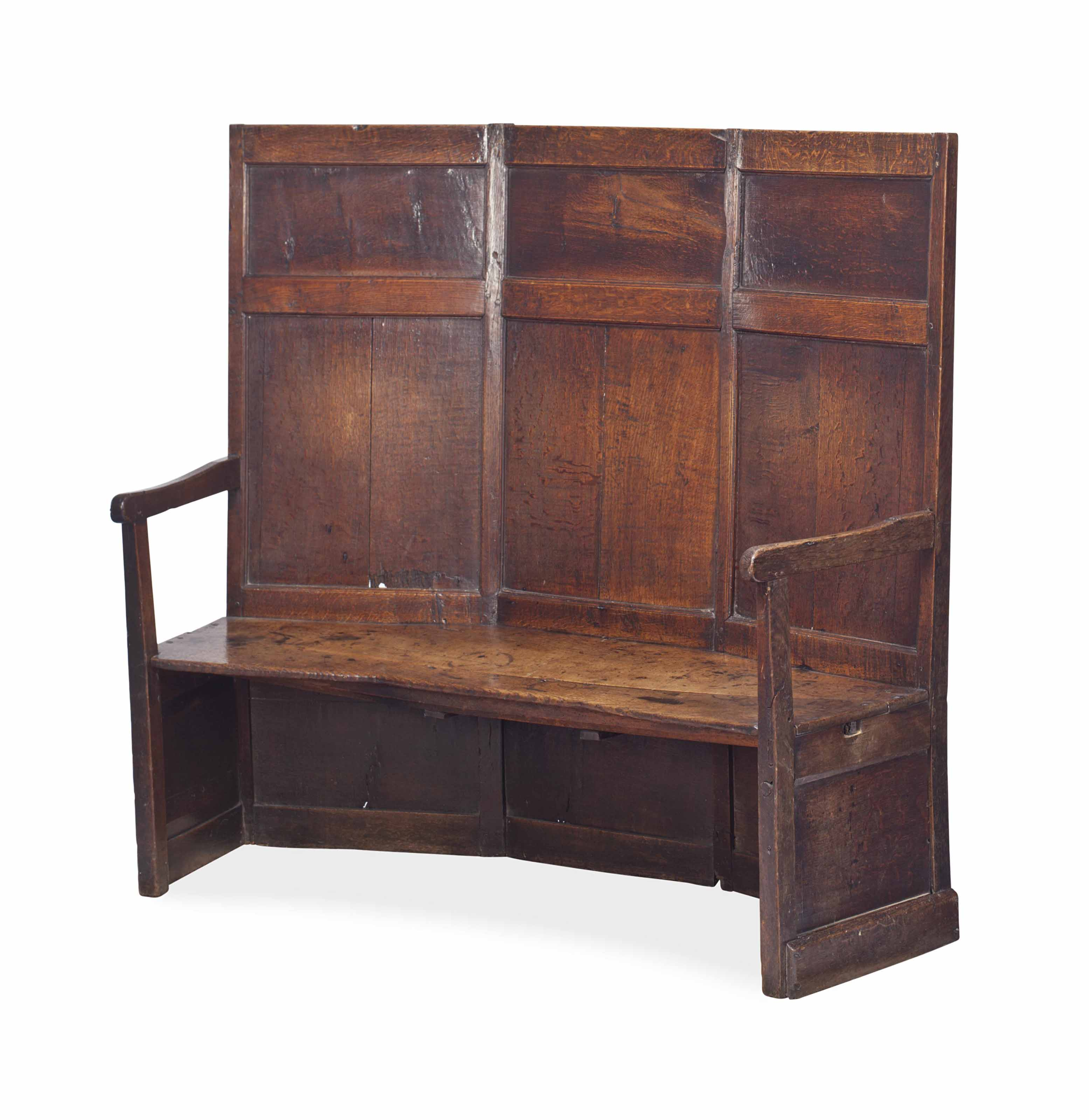 AN ENGLISH STAINED OAK SETTLE,