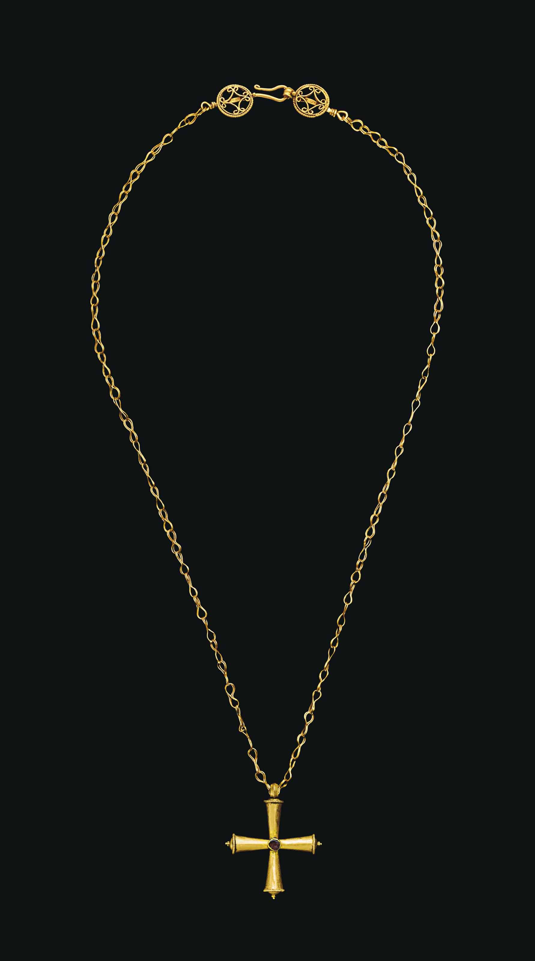 A BYZANTINE GOLD NECKLACE WITH A GOLD AND GARNET PENDANT CROSS