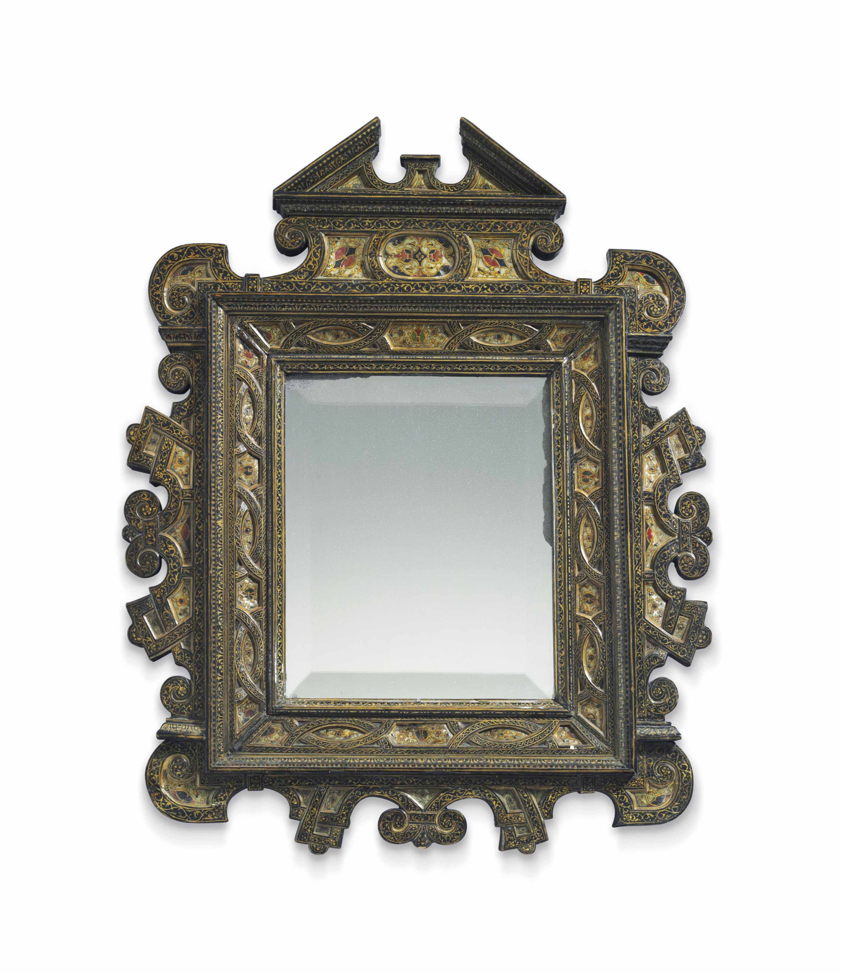 A NORTH ITALIAN MOTHER-OF-PEARL INLAID EBONIZED AND PARCEL-GILT MIRROR