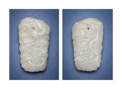 A WHITE JADE 'CLOUD' PENDANT