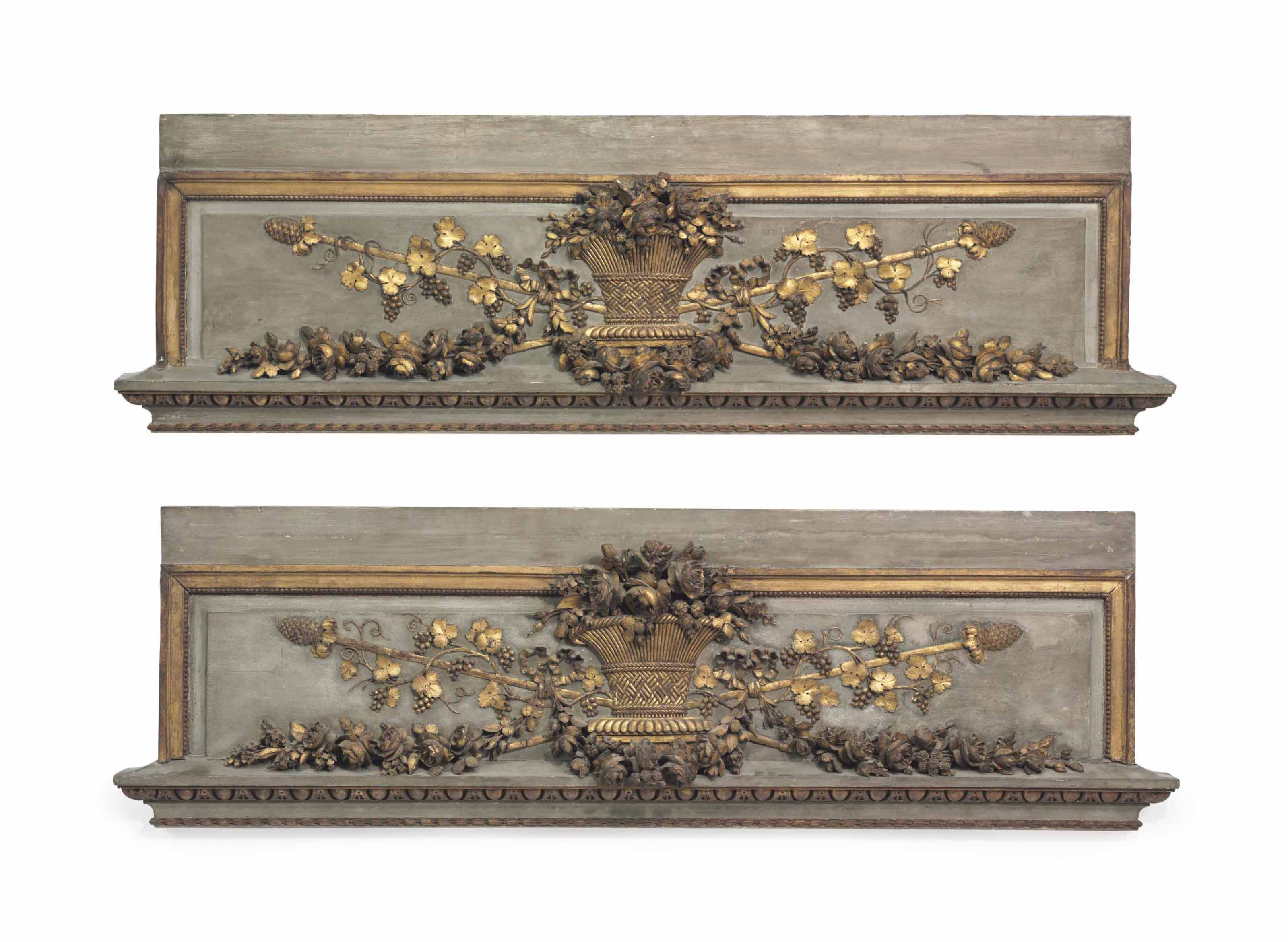 A PAIR OF LOUIS XVI GREY-PAINTED AND PARCEL-GILT OVERDOOR PANELS