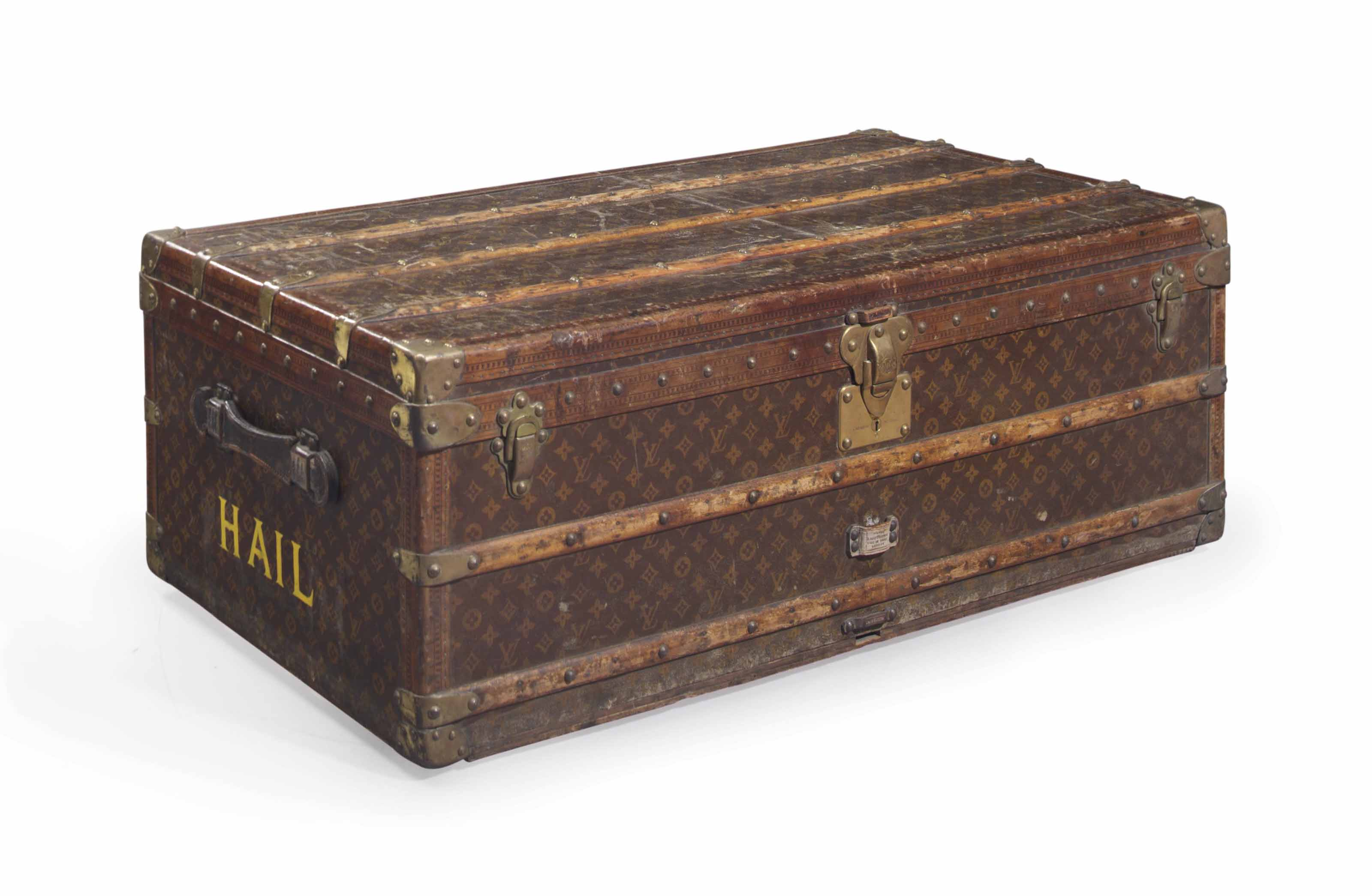 A LARGE LOUIS VUITTON TRAVELLING TRUNK