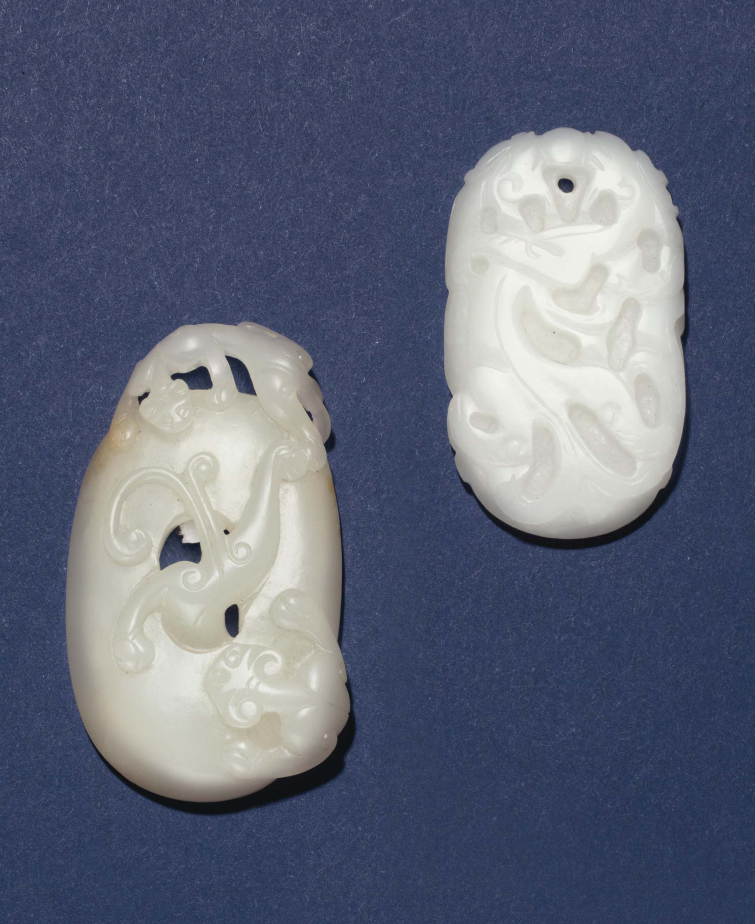 TWO WHITE JADE OVAL PENDANTS